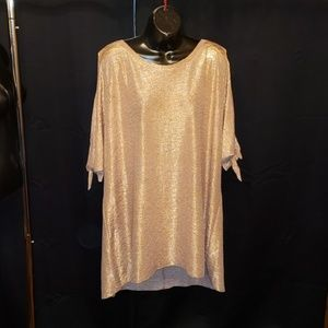 Shiny rose gold blouse with peekaboo arms